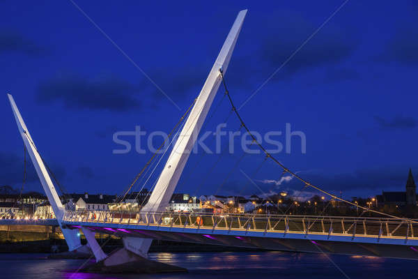 Full moon rising by Peace Bridge in Derry Stock photo © benkrut