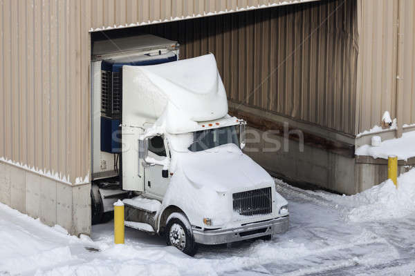 Semi truck and the warehouse seen winter time Stock photo © benkrut