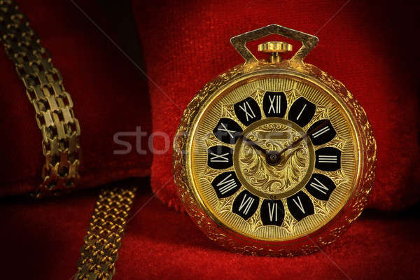 Pocket watch with golden chains Stock photo © berczy04