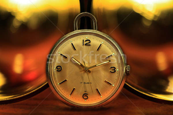 Pocket watch with golden lights Stock photo © berczy04
