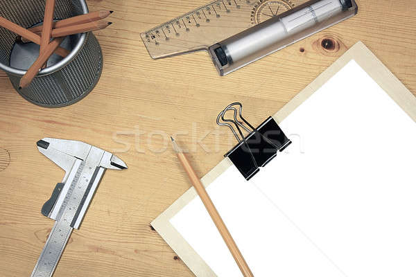 Blank white paper on wooden table with technical tools Stock photo © berczy04