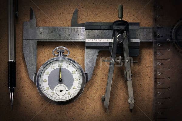Pocket watch with engineering tools Stock photo © berczy04