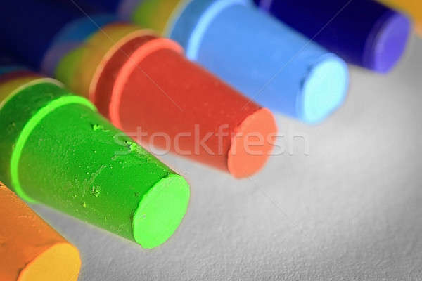 Colorful crayons on paper Stock photo © berczy04