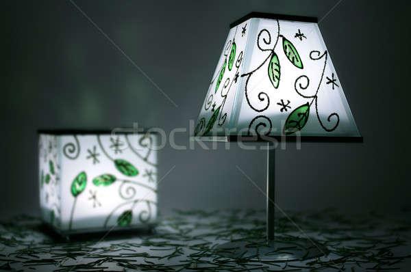 Dwa zielone Świeca lampy ciemności lampy Zdjęcia stock © berczy04
