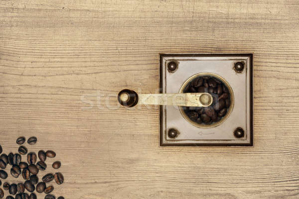Coffee grinder on wood Stock photo © berczy04