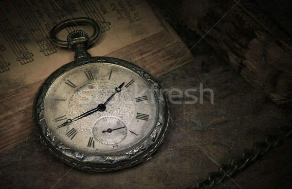 Old pocket watch on books Stock photo © berczy04