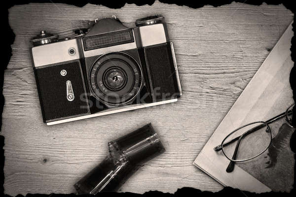 Old manual camera with newspaper and film Stock photo © berczy04