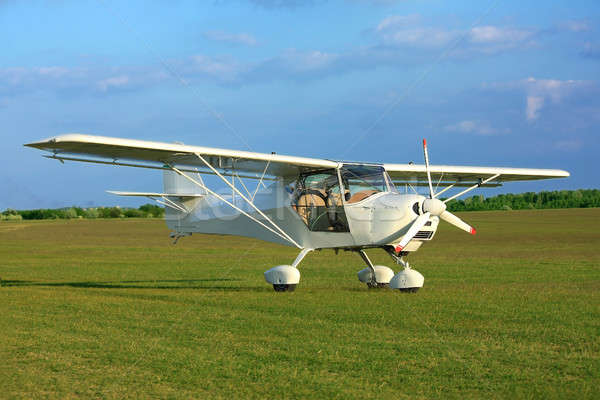 Ultra light aircraft on grass Stock photo © berczy04