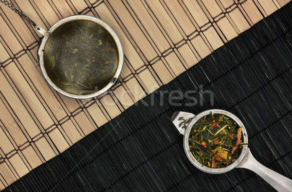 Tea-strainers on wooden diagonal Stock photo © berczy04