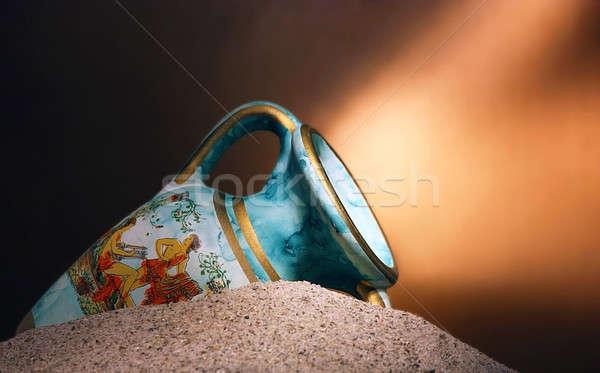 Old blue vase in sands Stock photo © berczy04