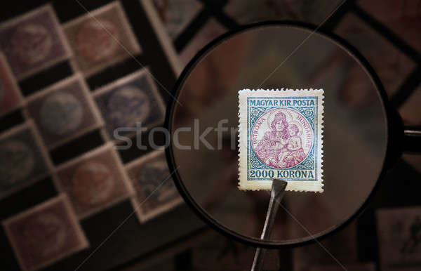 Old Hungarian post stamps with magnifying glass Stock photo © berczy04