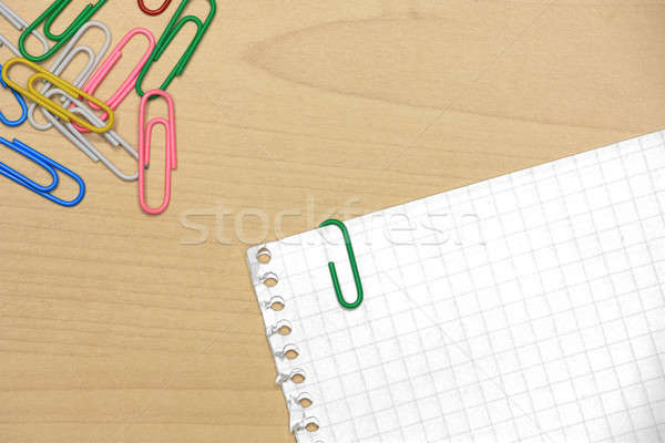 Paper clips on wood with grid papers Stock photo © berczy04
