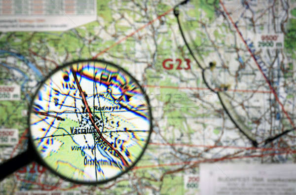 Flying map with magnifying glass Stock photo © berczy04