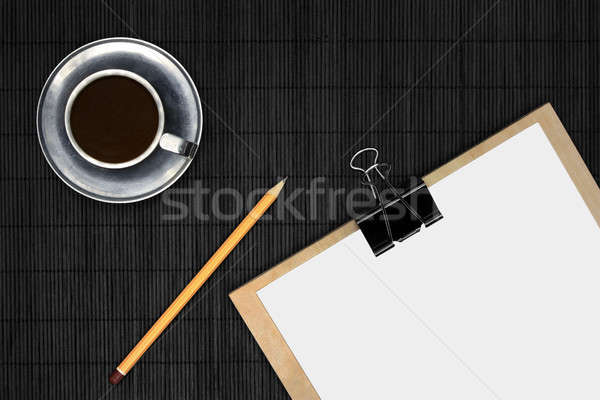 Empty paper on black desk with coffee Stock photo © berczy04