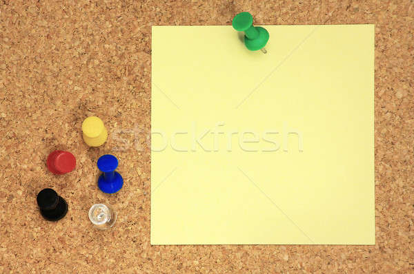 Post it and colorful thumbtacks on cork board Stock photo © berczy04