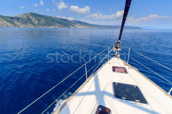 Bow of sailing boat / yacht with blue sea Stock photo © Bertl123