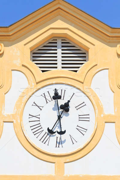 Ancient Clock on old building Stock photo © Bertl123