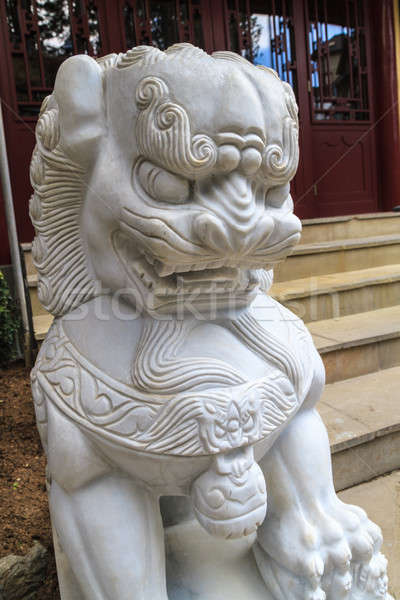 Chinese Lion guarding entrance of pagoda Stock photo © Bertl123