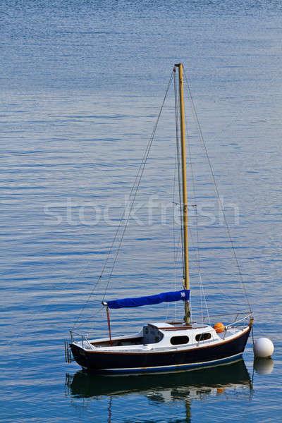 Single mast boat moored in a harbor  Stock photo © Bertl123