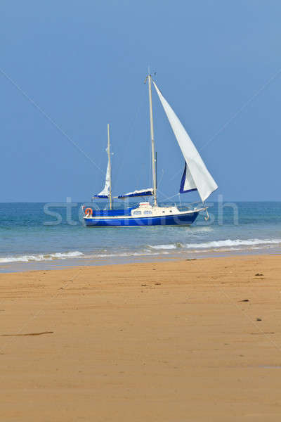 Blue Yacht anchored near sandy beach Stock photo © Bertl123
