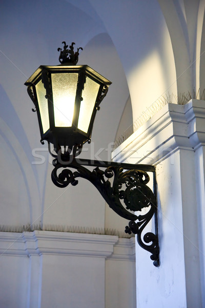 Iron cast street light illuminating old arches Stock photo © Bertl123