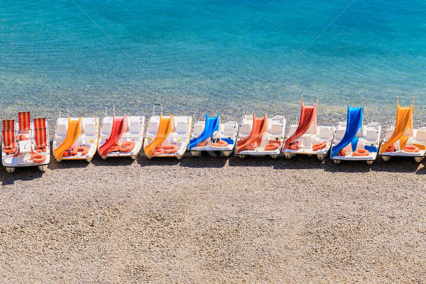 Colorful pedal boats on a beach Stock photo © Bertl123