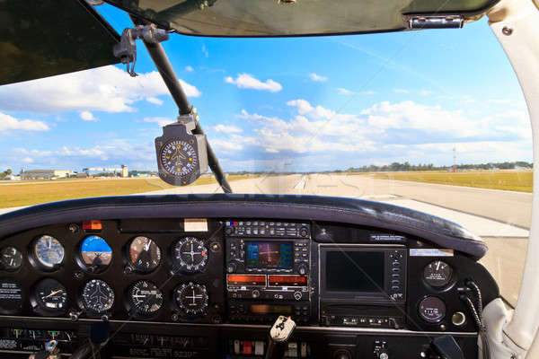 Cockpit view from small aircraft taking off from runway  Stock photo © Bertl123
