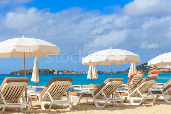 Beach chairs and parasols on a beach in a tropical paradise Stock photo © Bertl123