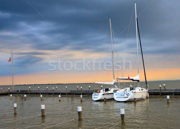 Stormy sunset with two yachts in marina Stock photo © Bertl123