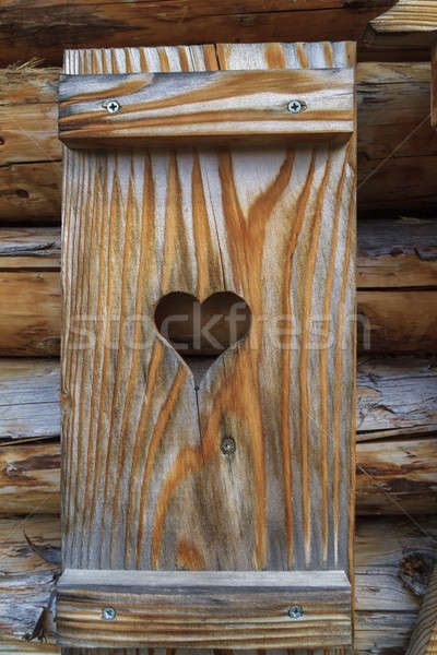 Window shutter with heart of a wooden log cabin in the European  Stock photo © Bertl123