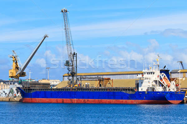 Cargo ship is being unloaded in port Stock photo © Bertl123