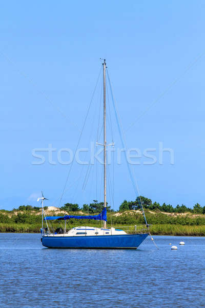 Sailing boat anchoring near beach coastline Stock photo © Bertl123