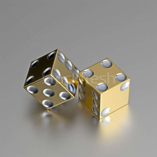 Golden right handed casino dice with silver eyes Stock photo © bestmoose