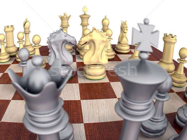 Metal chess set on wooden board, knights confronting. Stock photo © bestmoose