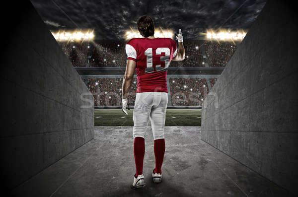 Futballista piros egyenruha sétál ki stadion Stock fotó © betochagas