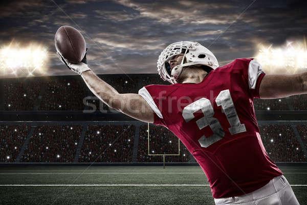 Foto stock: Futbolista · rojo · uniforme · pelota · estadio · deporte
