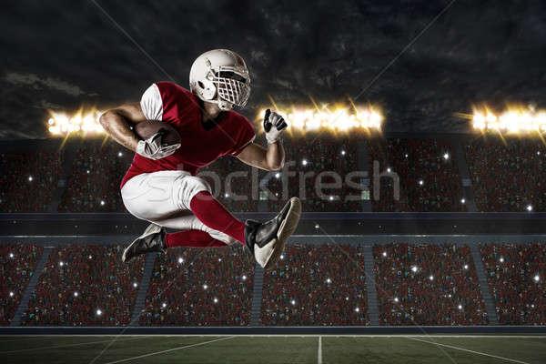 футболист красный равномерный работает стадион спорт Сток-фото © betochagas