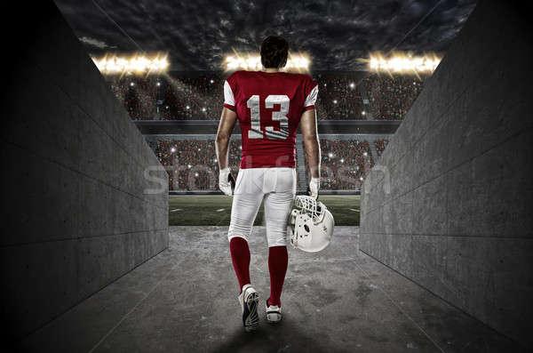 футболист красный равномерный ходьбе из стадион Сток-фото © betochagas