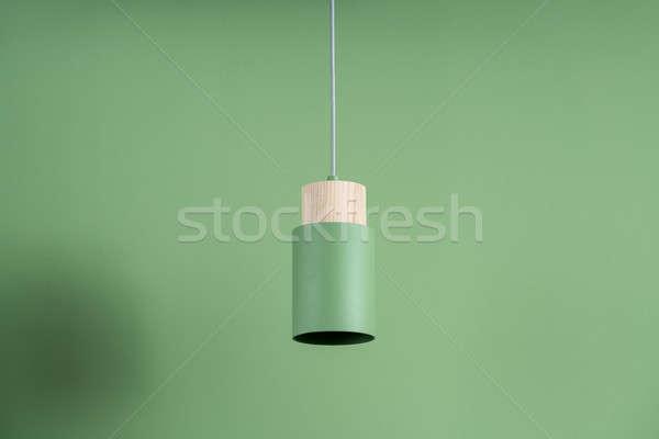 Hanging metal green lamp with wooden part Stock photo © bezikus