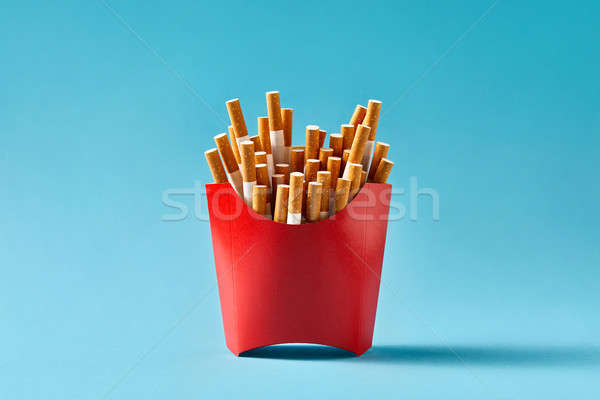 Many cigarettes in red carton Stock photo © bezikus
