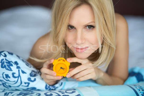Woman with clock Stock photo © bezikus