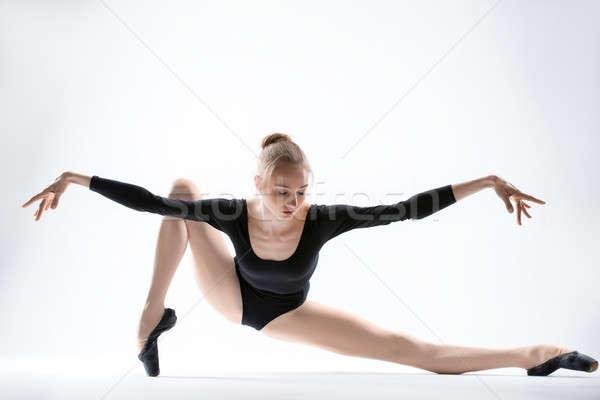Kecses ballerina fekete nyújtás izolált fehér Stock fotó © bezikus