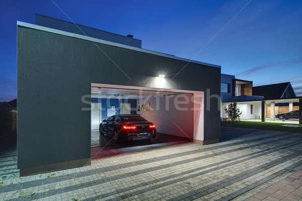 Glowing modern cottage with garage Stock photo © bezikus