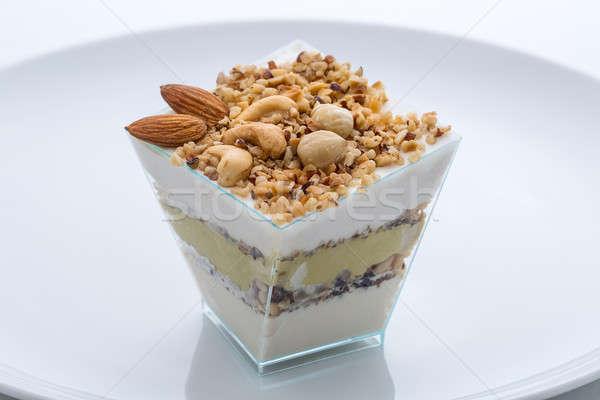 Congelés yogourt gâteau noix tasse plaque Photo stock © bezikus