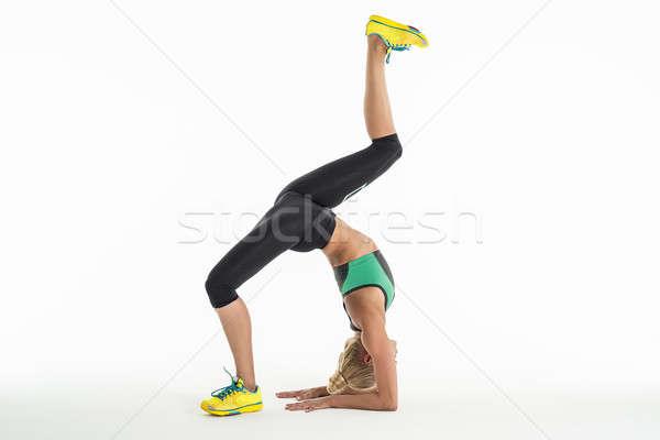 Rytmiczny gimnastyk wykonywania studio piękna odzież sportowa Zdjęcia stock © bezikus