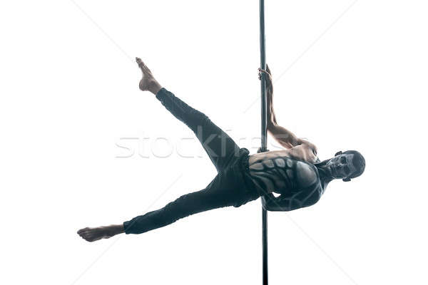 Male pole dancer with body-art on pylon Stock photo © bezikus