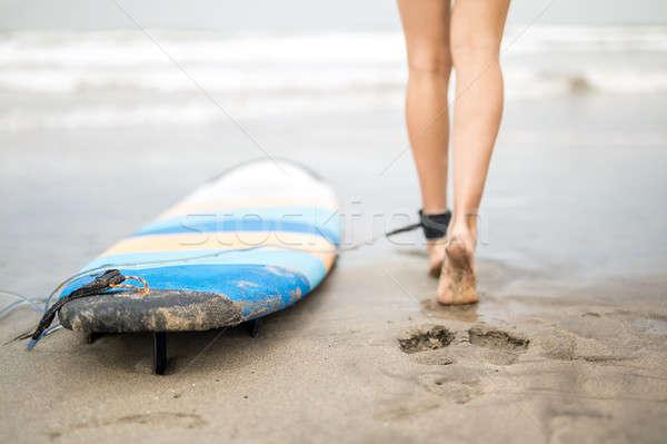 Woman's legs and surfboard Stock photo © bezikus