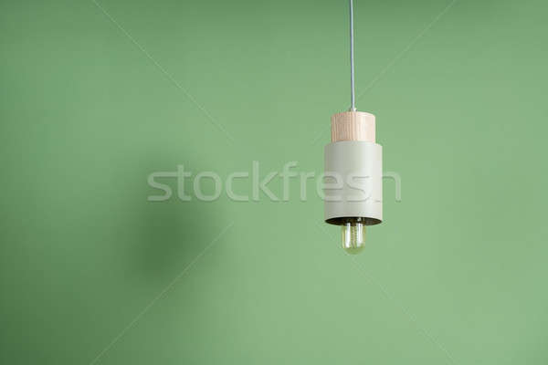 Hanging metal beige edison lamp with wooden part Stock photo © bezikus
