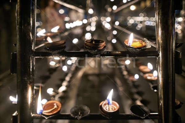 Óleo velas dentro budista templo ardente Foto stock © bezikus