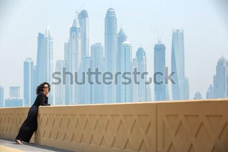 Woman on the background of skyscrapers Stock photo © bezikus